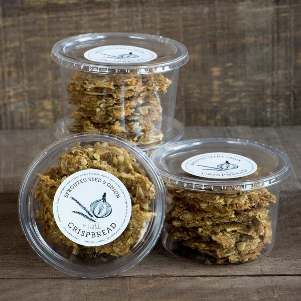 Sprouted Seed & Onion Crispbread. Four containers stacked.