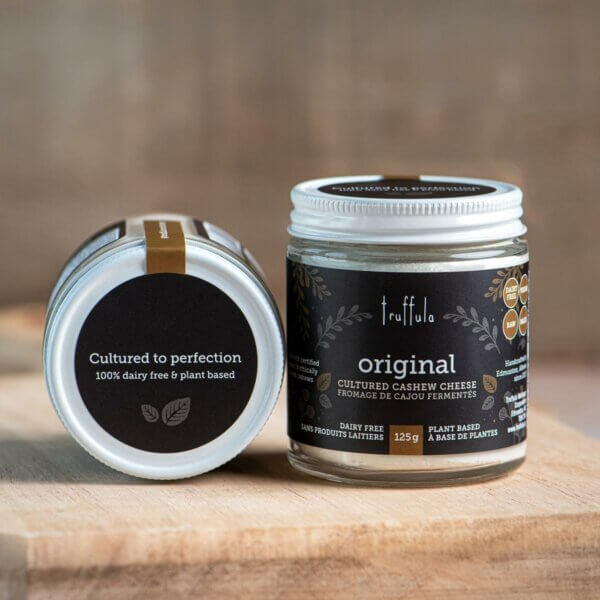 """Two Original Cultured Cashew Cheese 125g jars, with one placed on its side to show the lid label, which says """"Cultured to perfection 100% dairy free & plant based"""""""